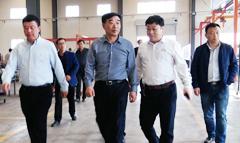 海拉尔农垦集团董事长李洪斌到我公司参观考察